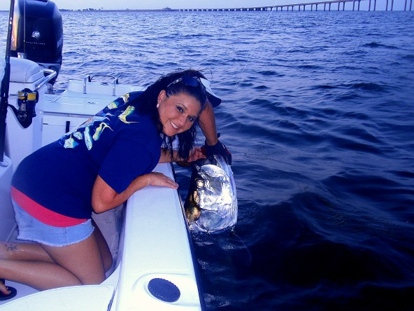 melissa witha 140lb tarpon caught while florida tarpon fishing near the sunshine skyway bridge during the spring and summer tarpon season